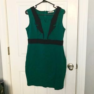 Deep green dress with black lapels from Mystic XL
